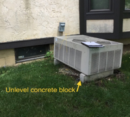 Air Conditioner Sitting On Unleveled Concrete Block