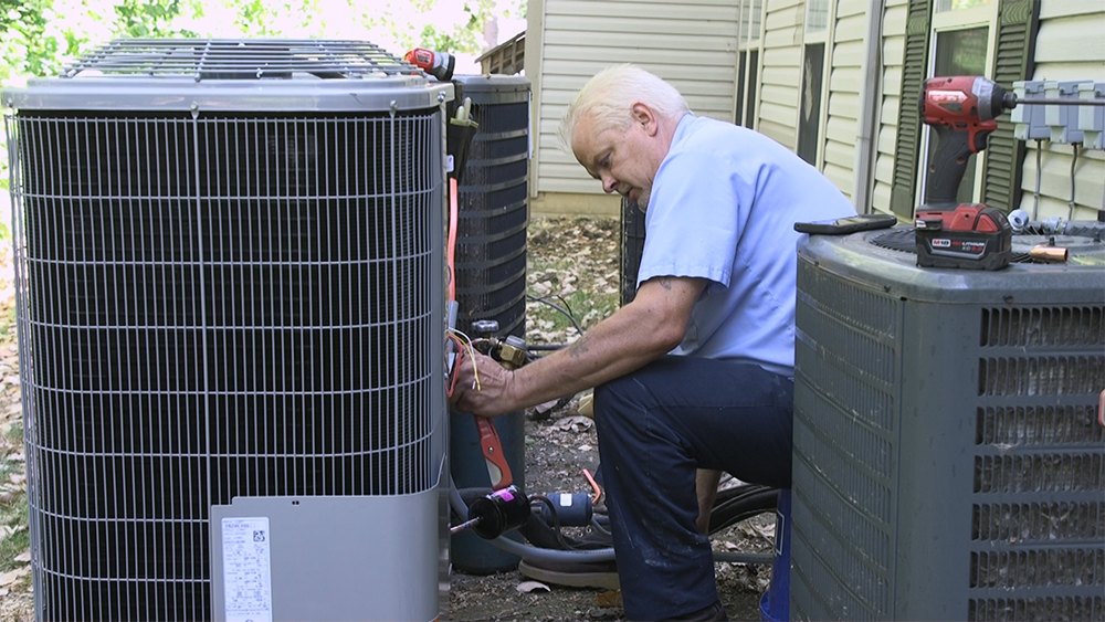 Technician working on an air conditioner.