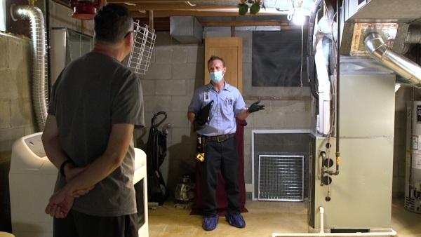 A technician talking about a furnace.