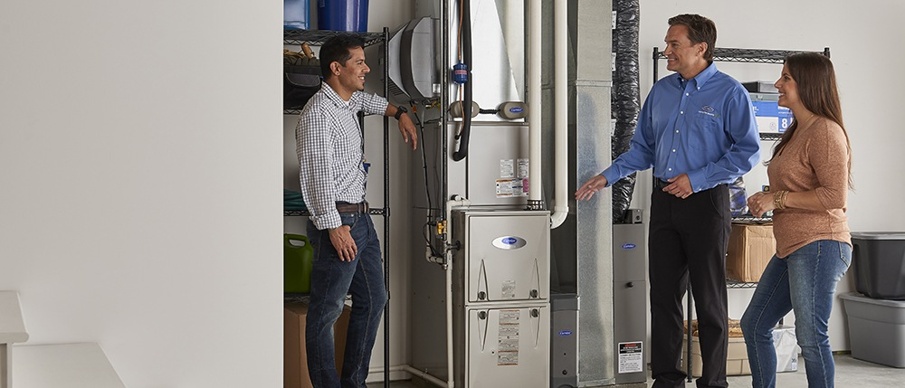 Showing a new furnace to homeowners
