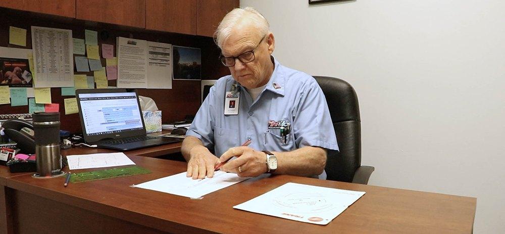 Arne working on an HVAC plan