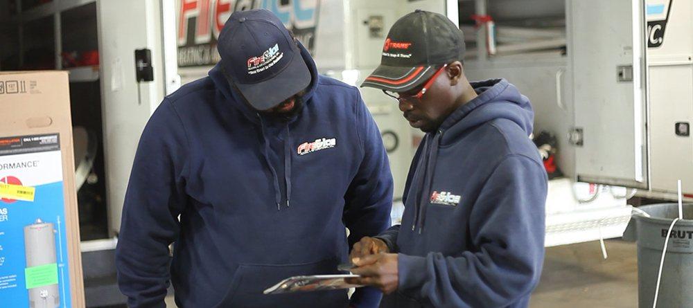 HVAC Technicians Reviewing a Job