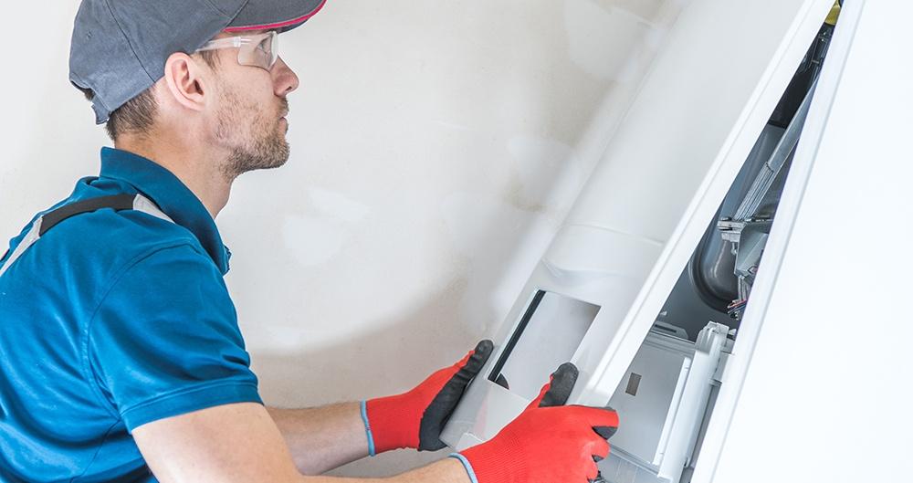 HVAC Technician Replacing a Panel